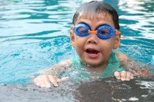 Young boy swimming in pool