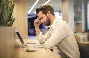 Man sitting at desk studying